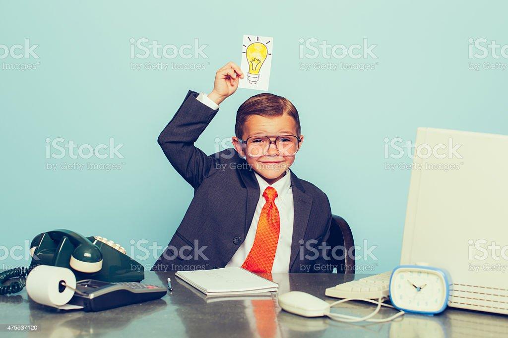 Young Boy Businessman Has Big Ideas stock photo