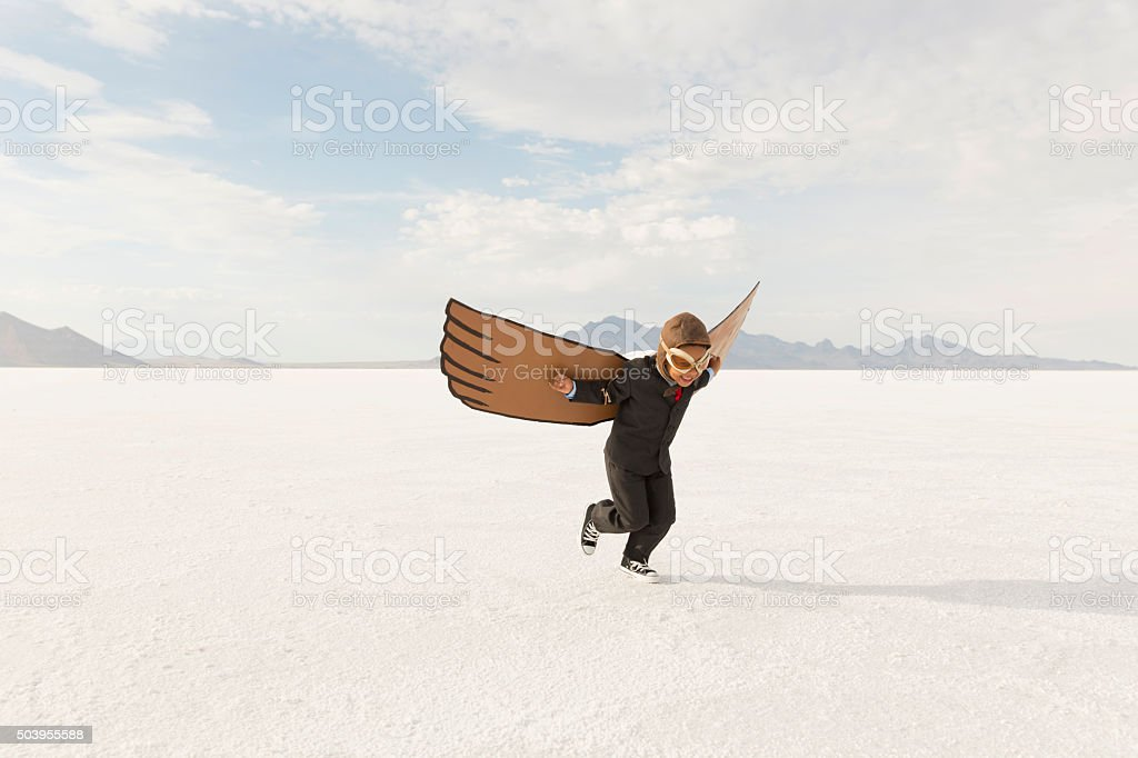 Young Boy Businessman is Flying Away stock photo