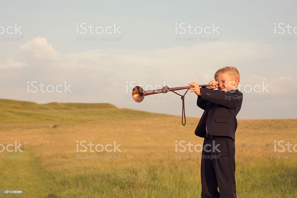 Young Boy Businessman Looking through a Trumpet stock photo