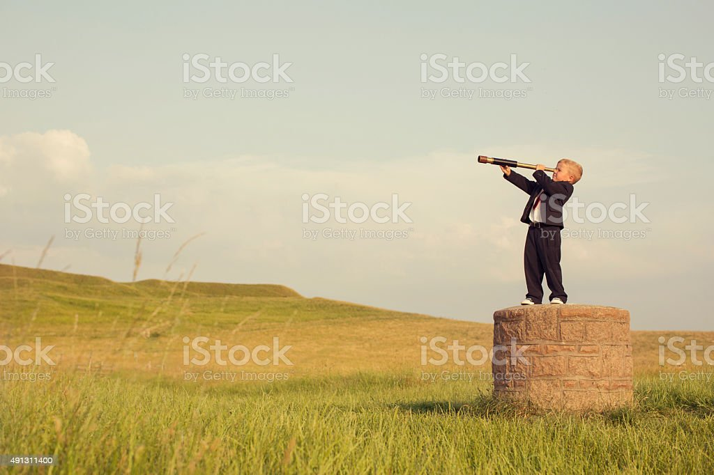 Young Boy Businessman Looking throught Telescope stock photo