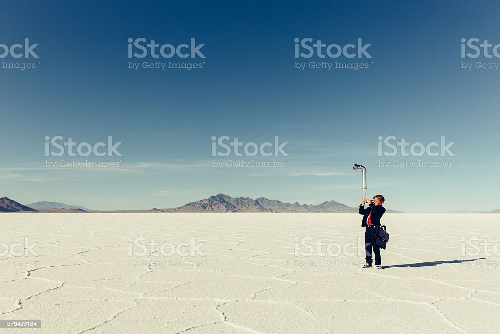 Young Boy Businessman Looks for New Oppurtunities with Periscope stock photo