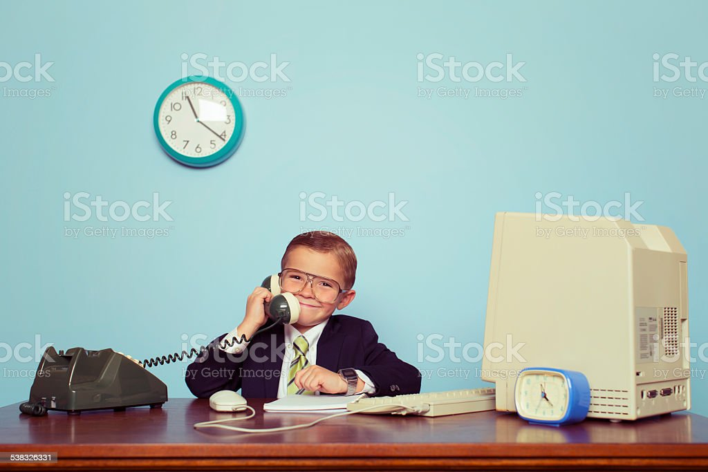 Young Boy Businessman Talks on the Telephone stock photo