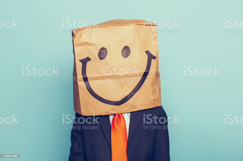 Young Boy Businessman Wears Happy Face stock photo