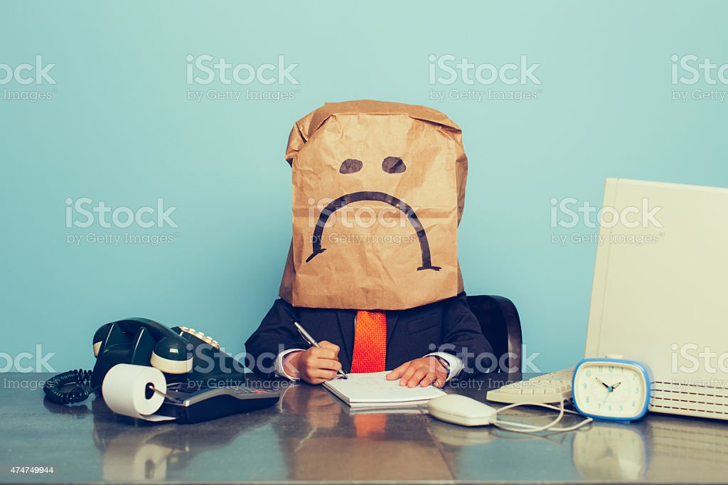Young Boy Businessman Wears Sad Face stock photo