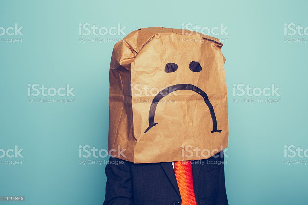 Young Boy Businessman Wears Sad Face stock photo