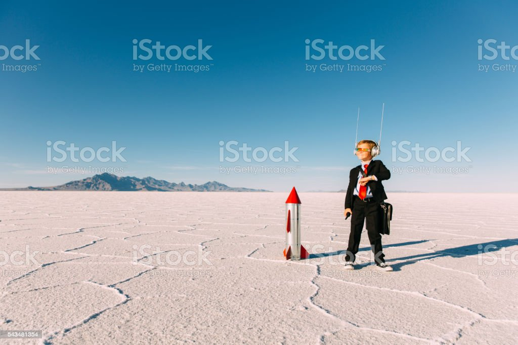 Young Boy Businessman With Rocket stock photo