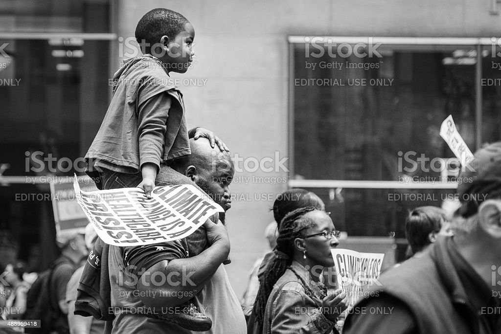 Young boy carried on the shoulders of a man, NYC stock photo