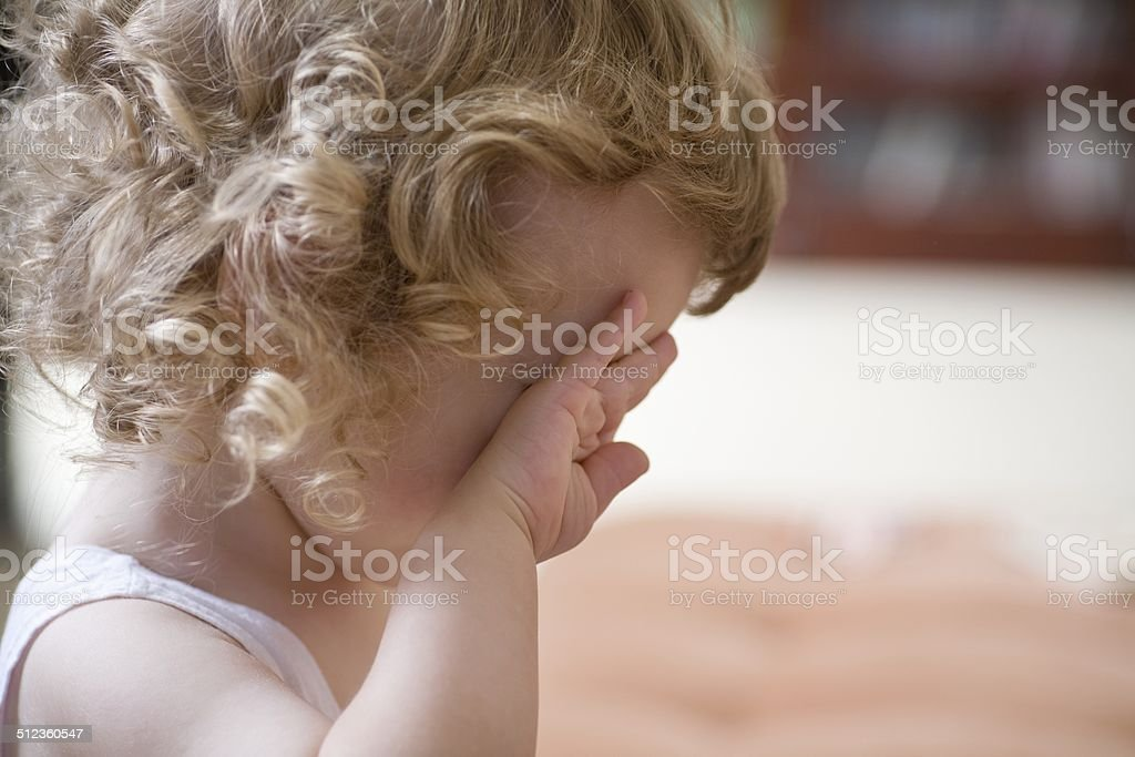 Young boy crying stock photo