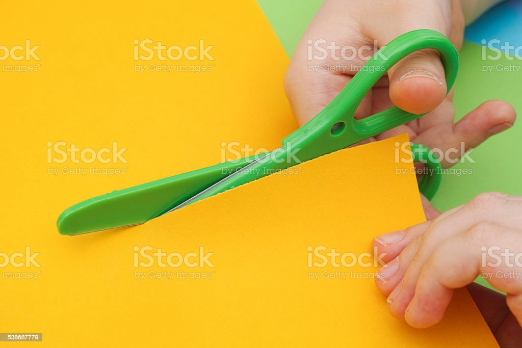 Young boy cutting paper stock photo