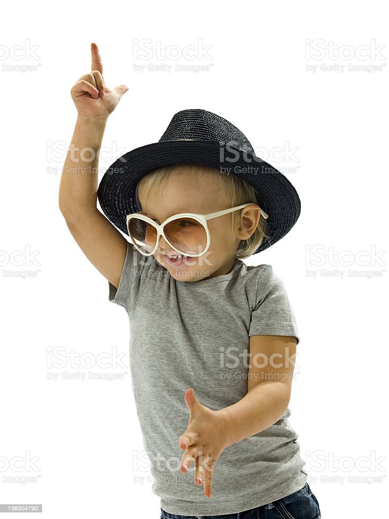Young boy dancing goofily wearing large hat and glasses royalty-free stock photo