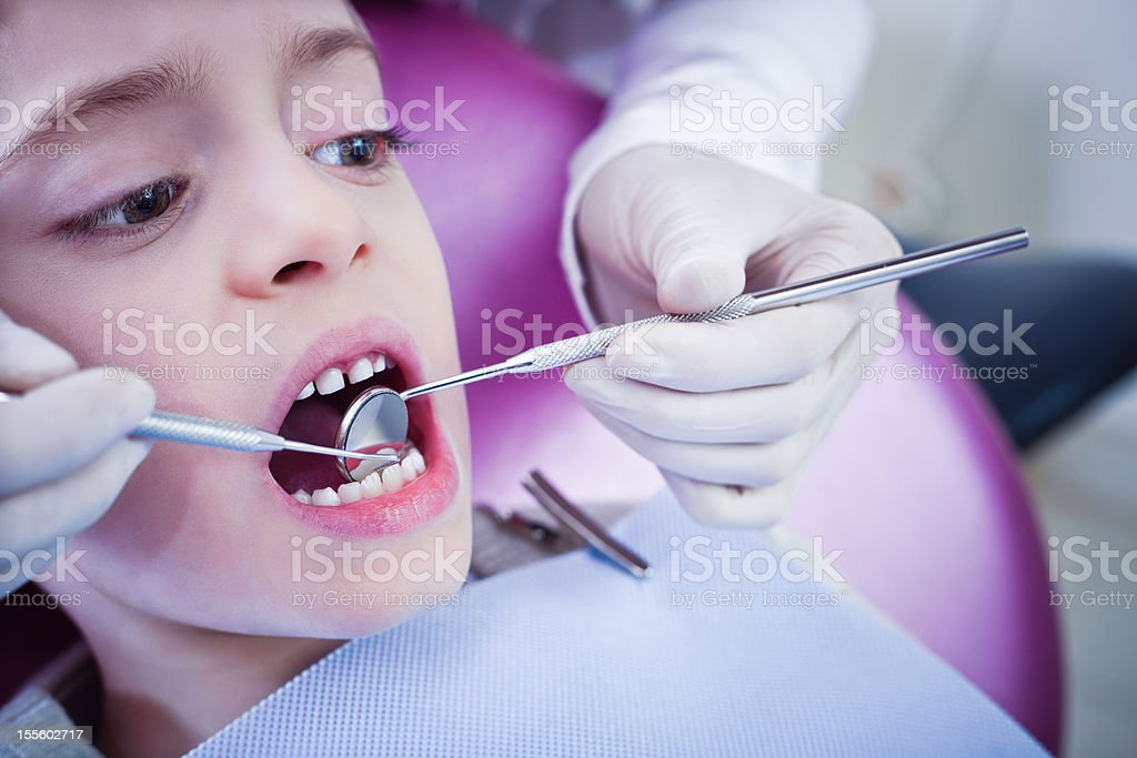 Young Boy Dental Patient Getting Examination royalty-free stock photo