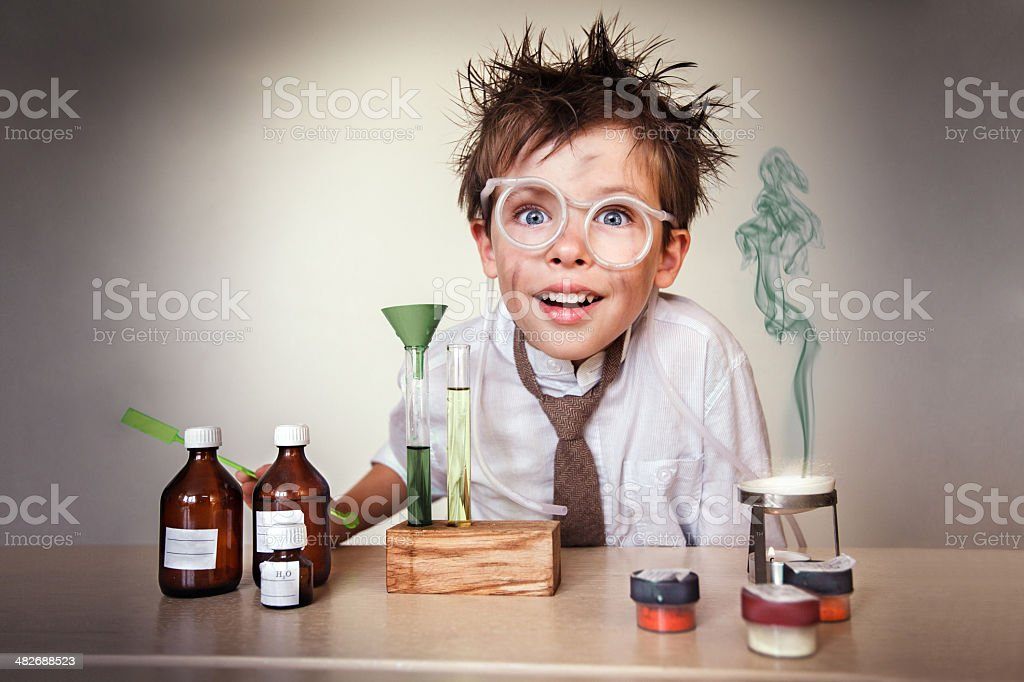 Young boy disheveled scientist with experiments stock photo