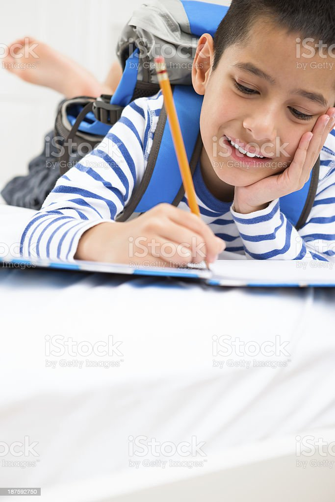 Young boy doing homework royalty-free stock photo