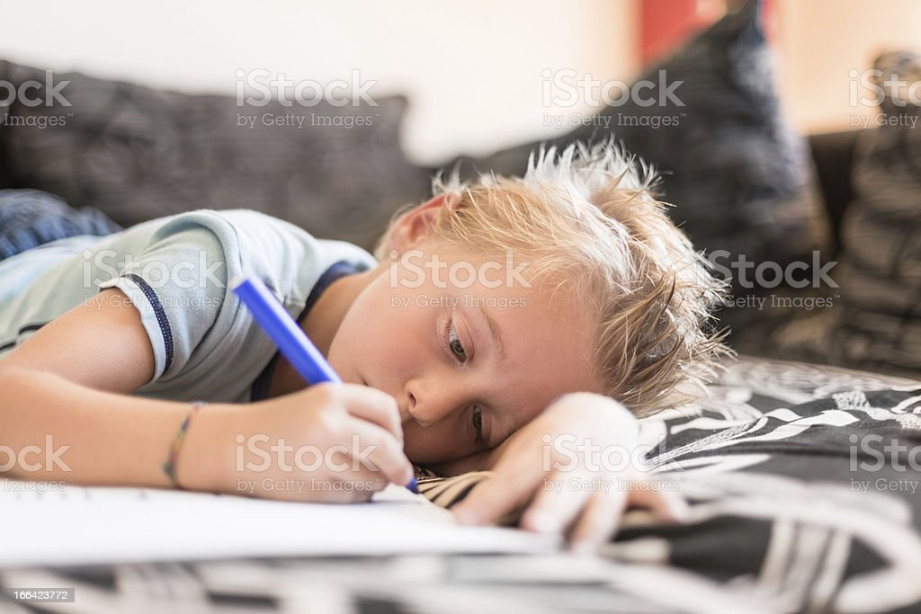 Young boy doing homeworks royalty-free stock photo