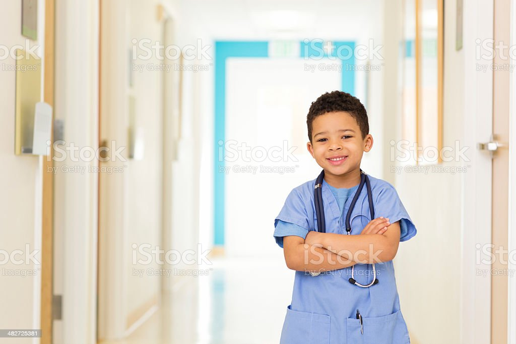 Young Boy Dressed as Doctor at Hospital stock photo
