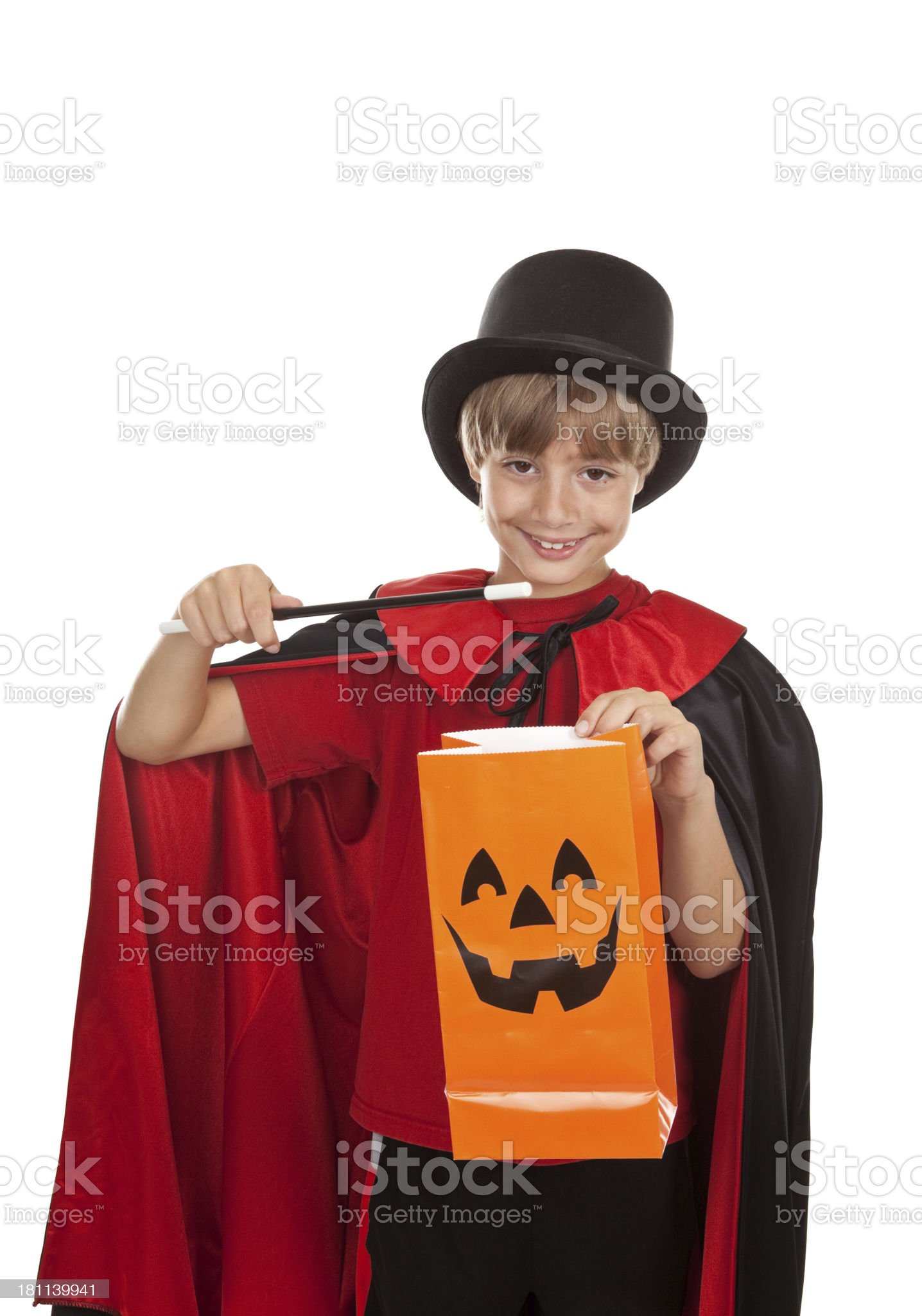 Young Boy Dressed As Magician With Trick-or-Treat Bag royalty-free stock photo