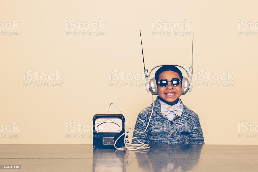 Young Boy Dressed as Nerd with Alien Headphones stock photo
