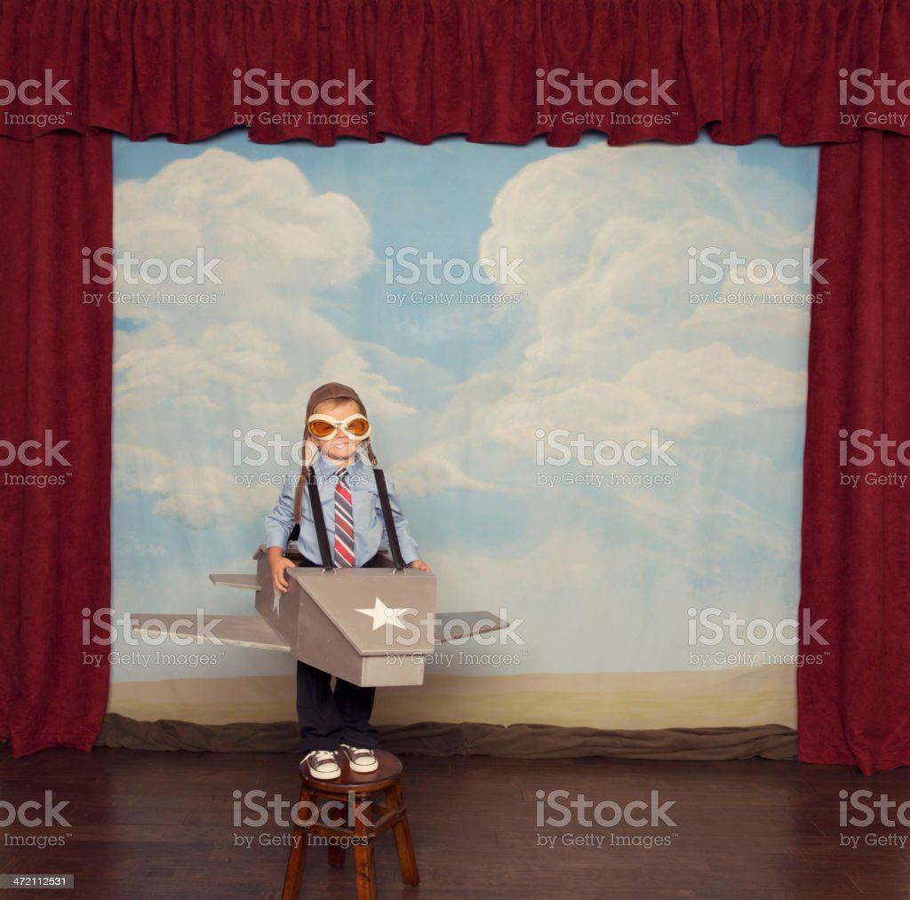 Young Boy Dressed as Pilot in Toy Airplane stock photo