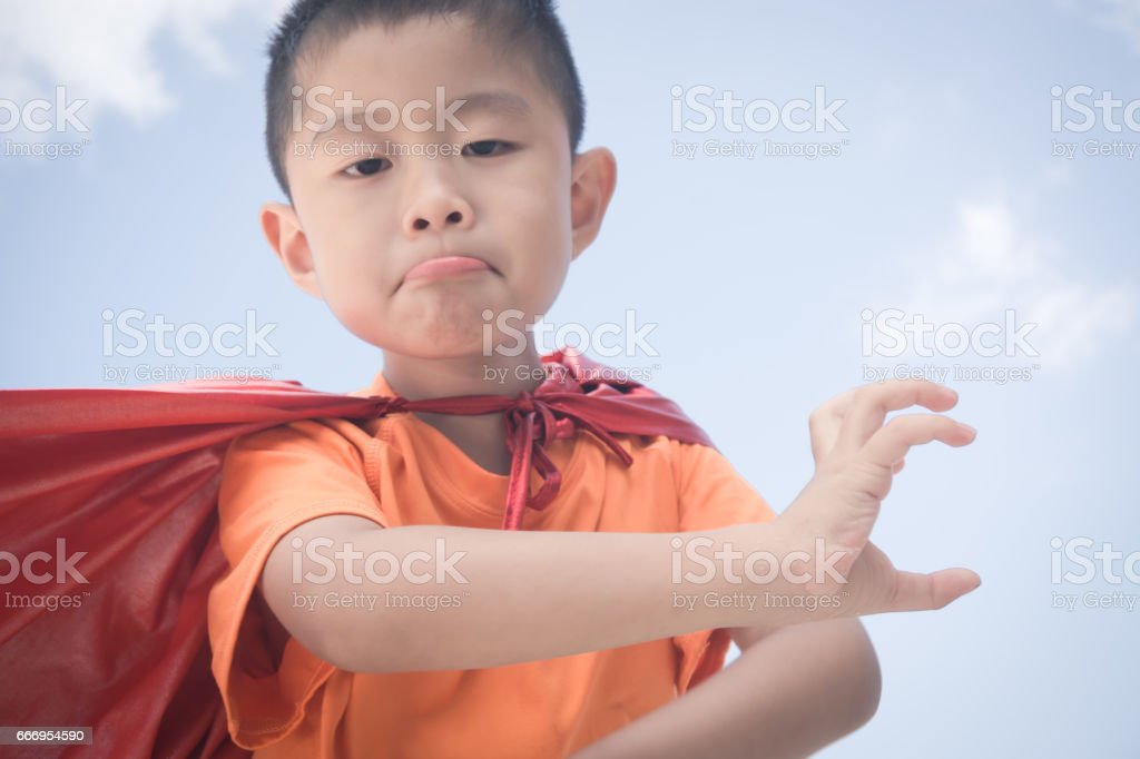 Young boy dressed as superhero stock photo