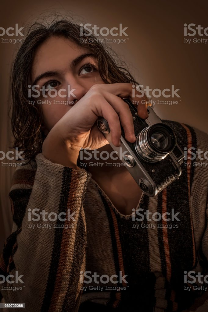 Young boy dressed in sweater with old Russian camera stock photo