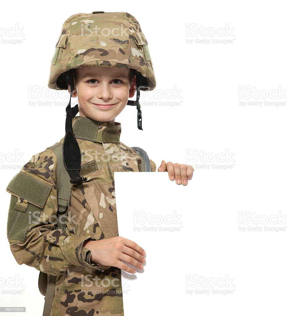 Young boy dressed like a soldier hoding placard royalty-free stock photo