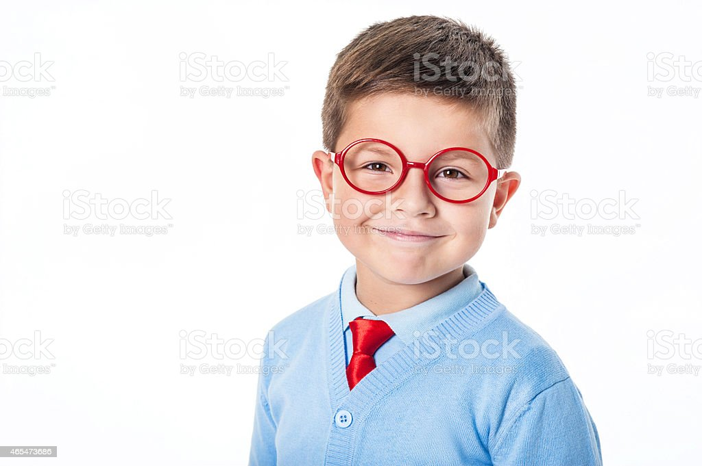 A young boy dressed nicely and wearing red glasses stock photo