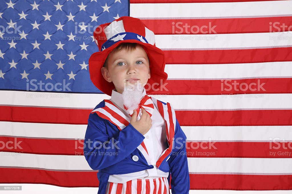 Young boy dressed up like Uncle Sam stock photo