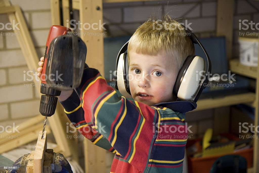 Young boy drilling royalty-free stock photo