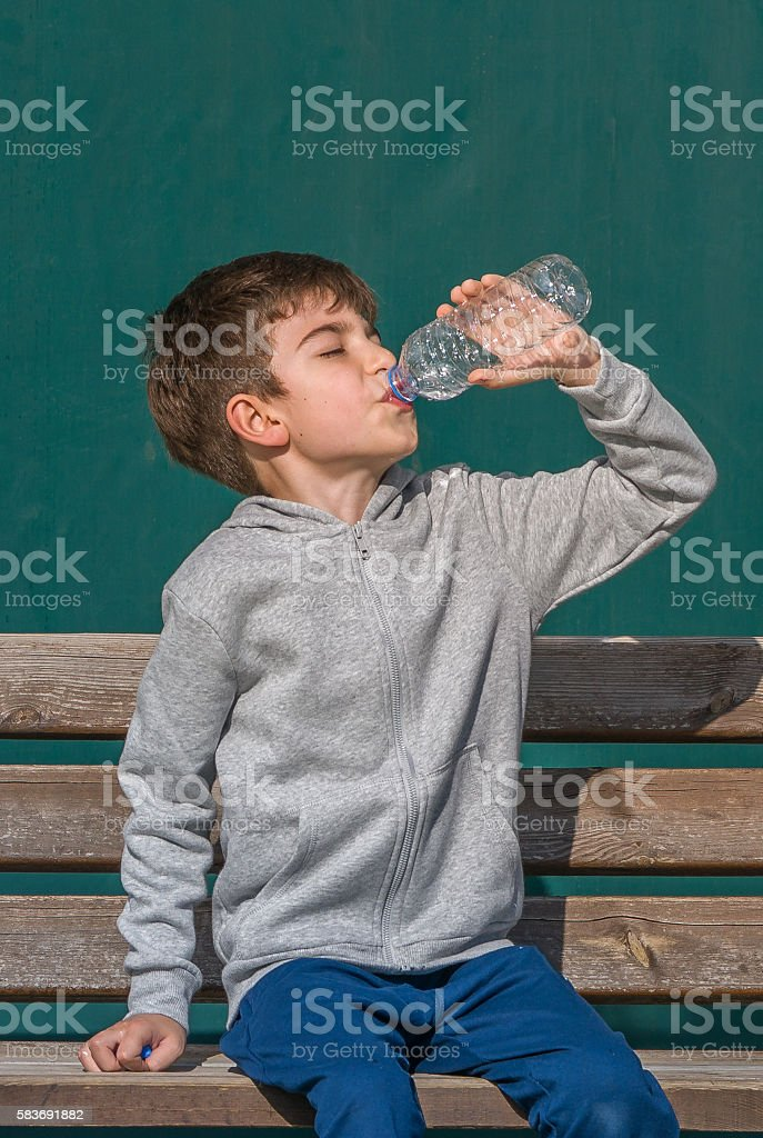 Young Boy Drinking Water stock photo