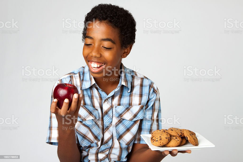 Young boy eating an apple royalty-free stock photo