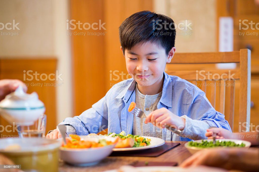 Young boy eating lunch stock photo