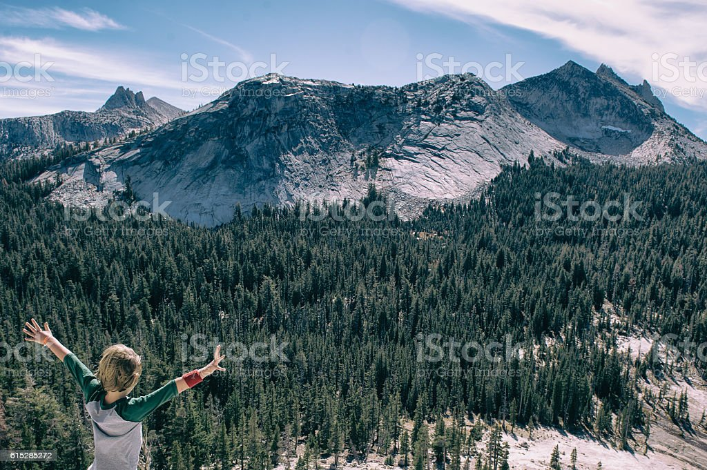 Young boy embracing the beauty of Tuolumne Meadows stock photo