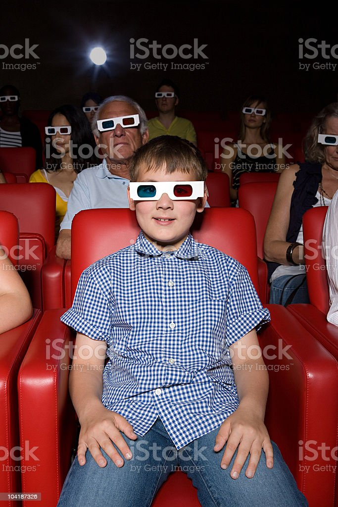 Young boy enjoying a 3d movie royalty-free stock photo