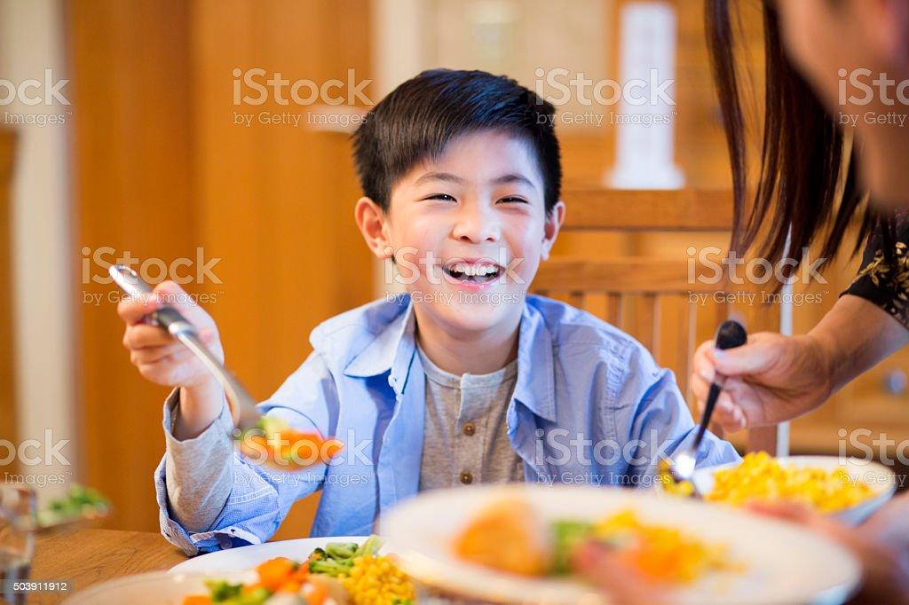 Young boy enjoying lunch stock photo