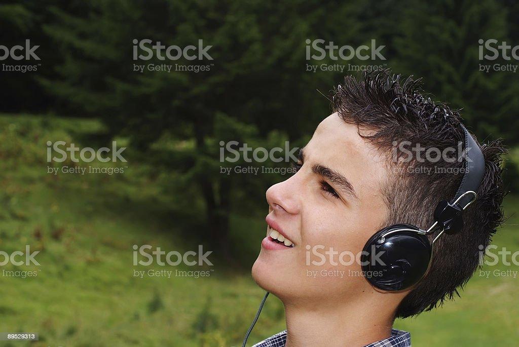 Young boy enjoying music royalty-free stock photo