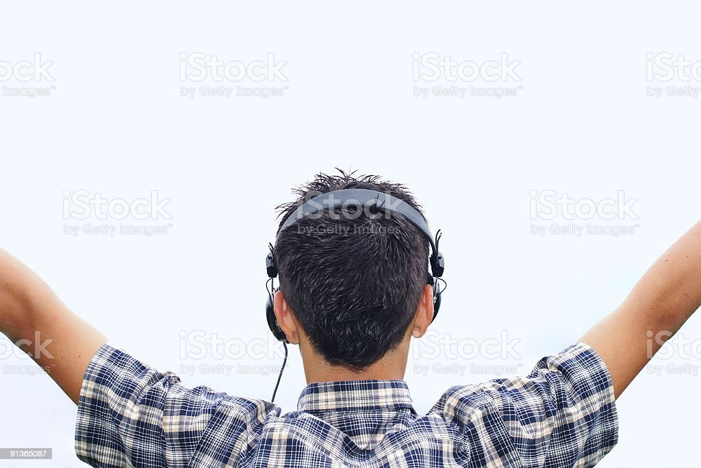 Young boy enjoying music royalty-free stock photo