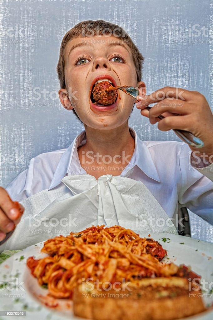 Young Boy Enjoys a Big Meatball stock photo