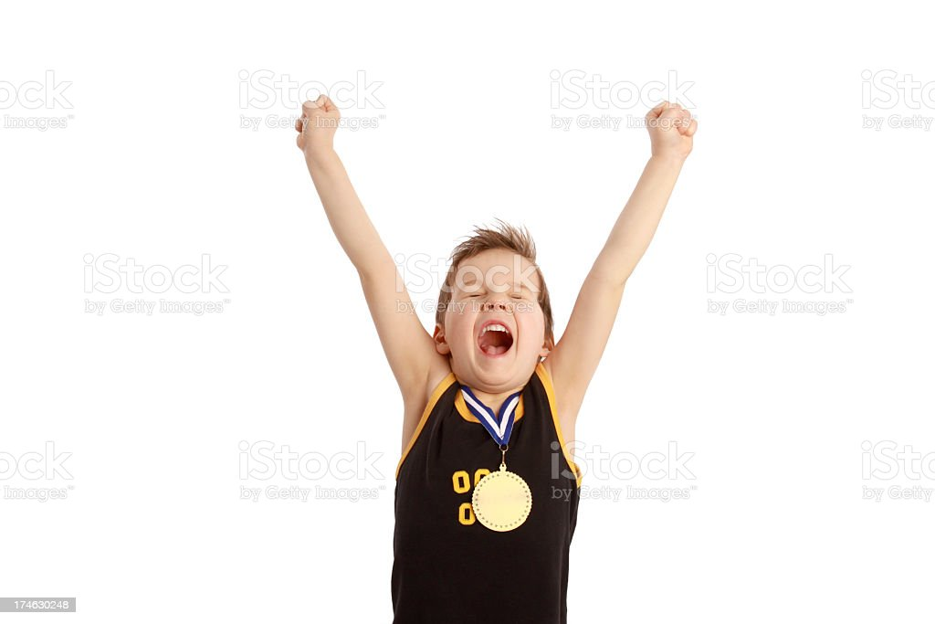 A young boy excited about winning a medal stock photo
