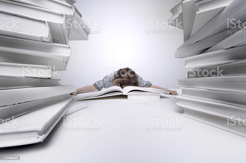Young boy falling asleep on his homework royalty-free stock photo