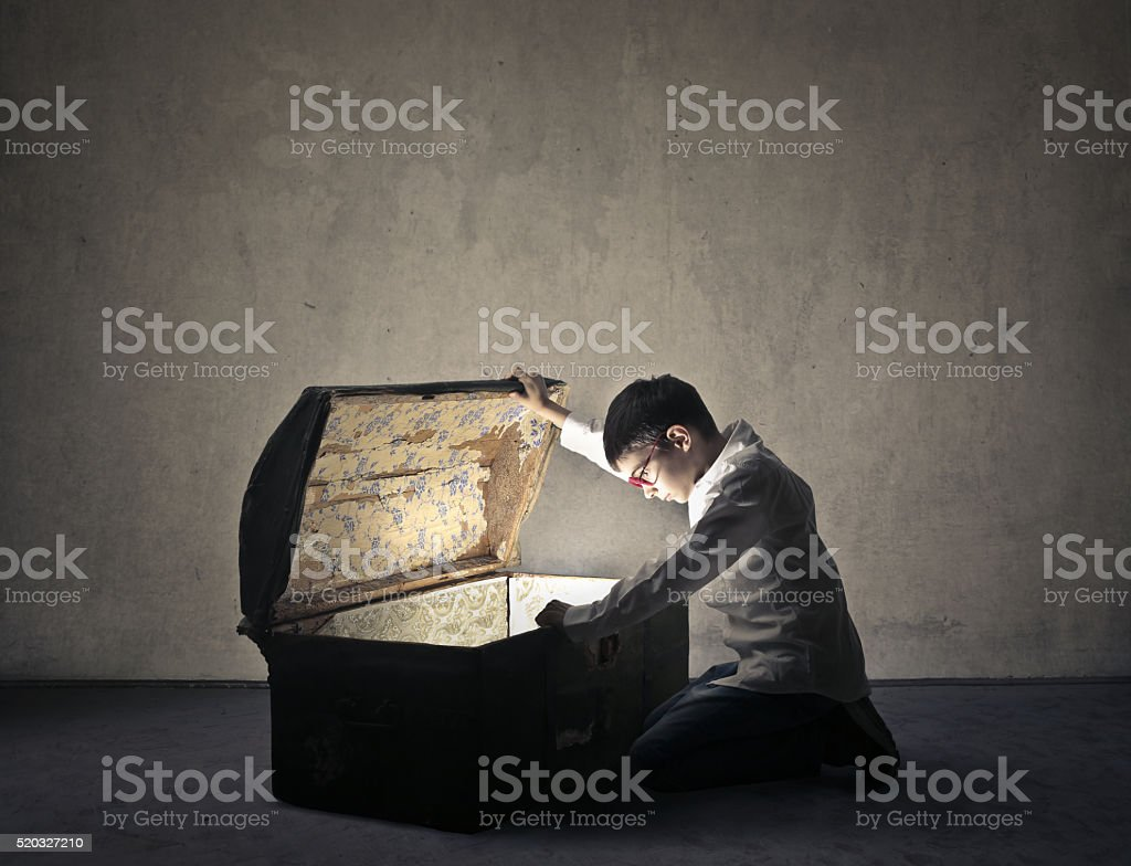 Young boy finding treasure stock photo