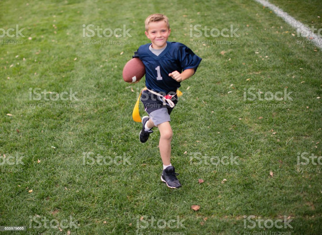 Young Boy Flag Football Player Scores Touchdown stock photo