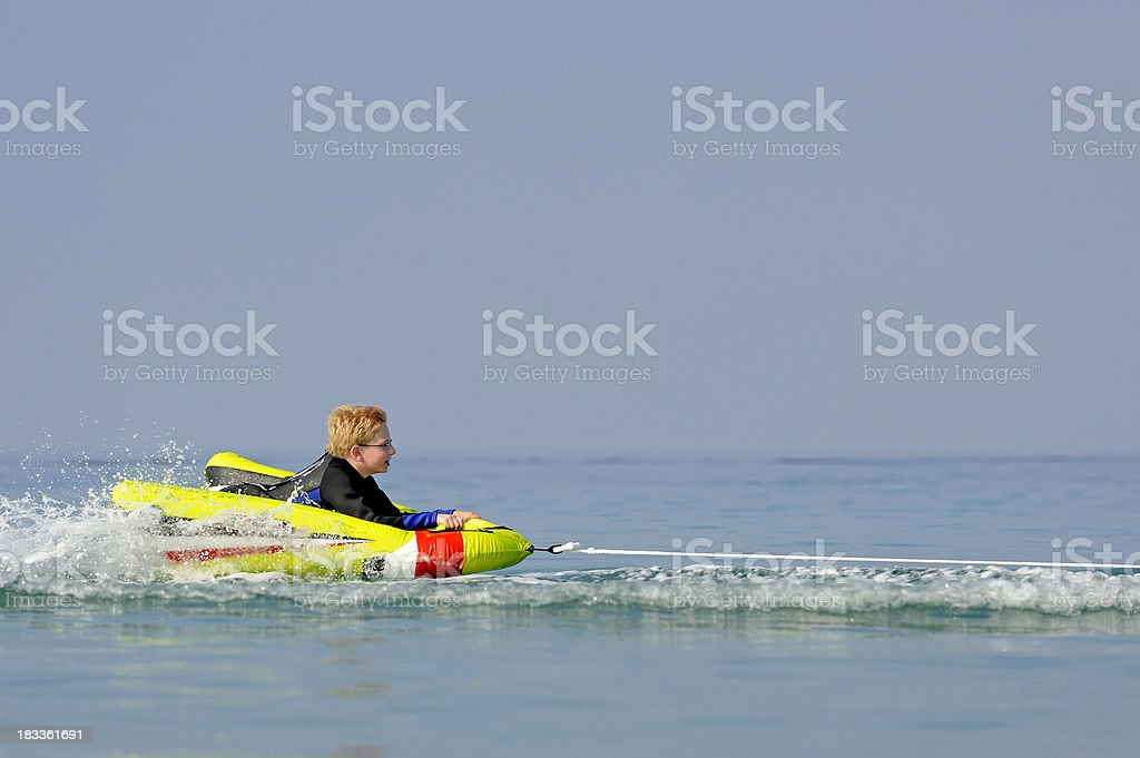 Young Boy Floating On The Water royalty-free stock photo