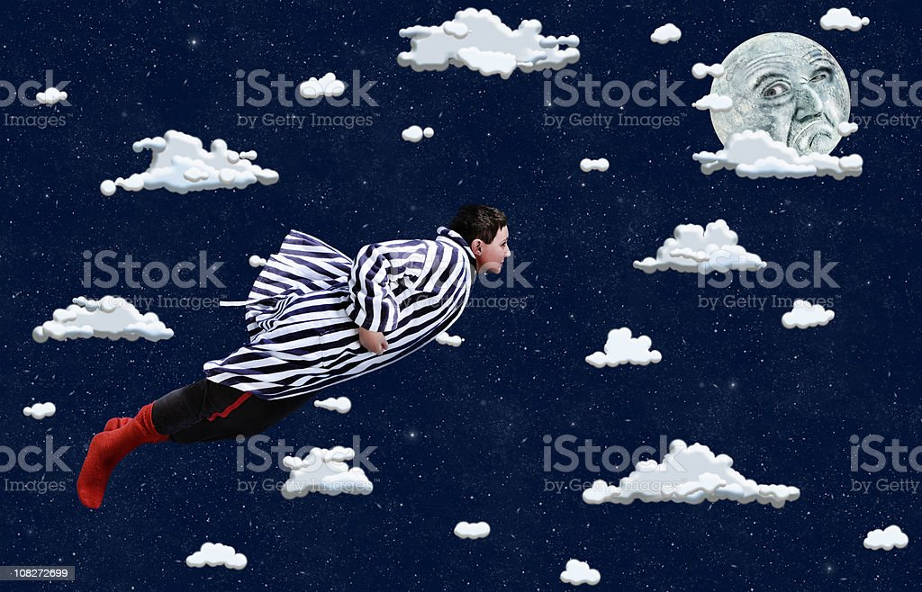 Young Boy Flying Through Cartoon Clouds stock photo
