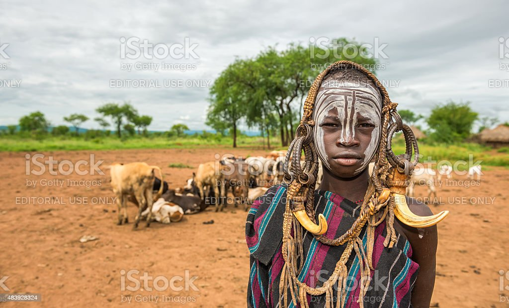 Young boy from the African tribe Mursi, Ethiopia stock photo