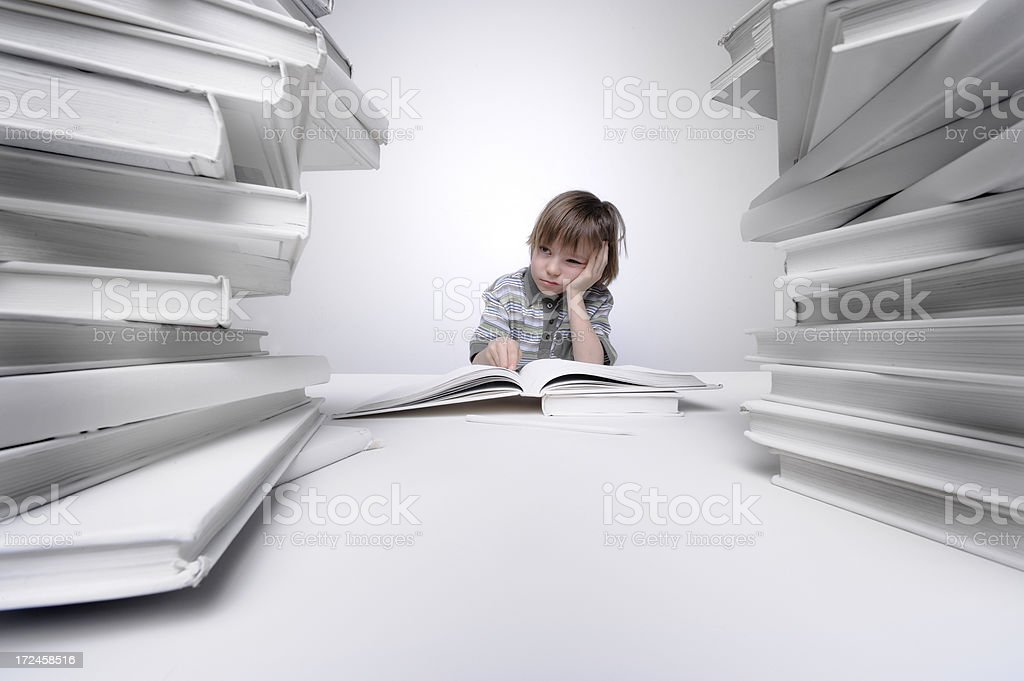 Young boy frustrated with homework. royalty-free stock photo