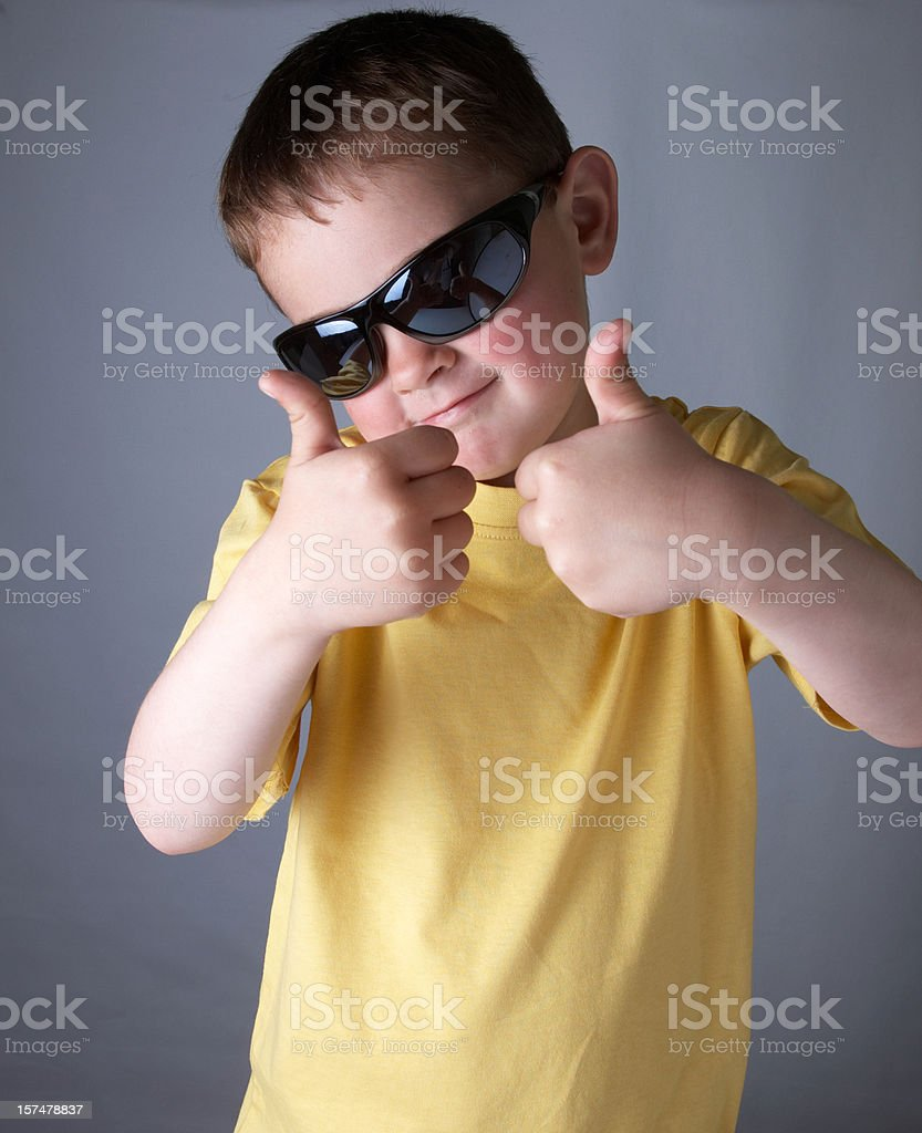 Young boy gives the thumbs up stock photo