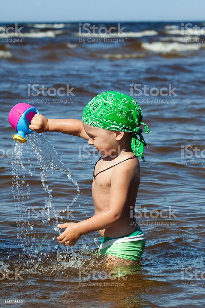 young boy have fun in water at sea royalty-free stock photo