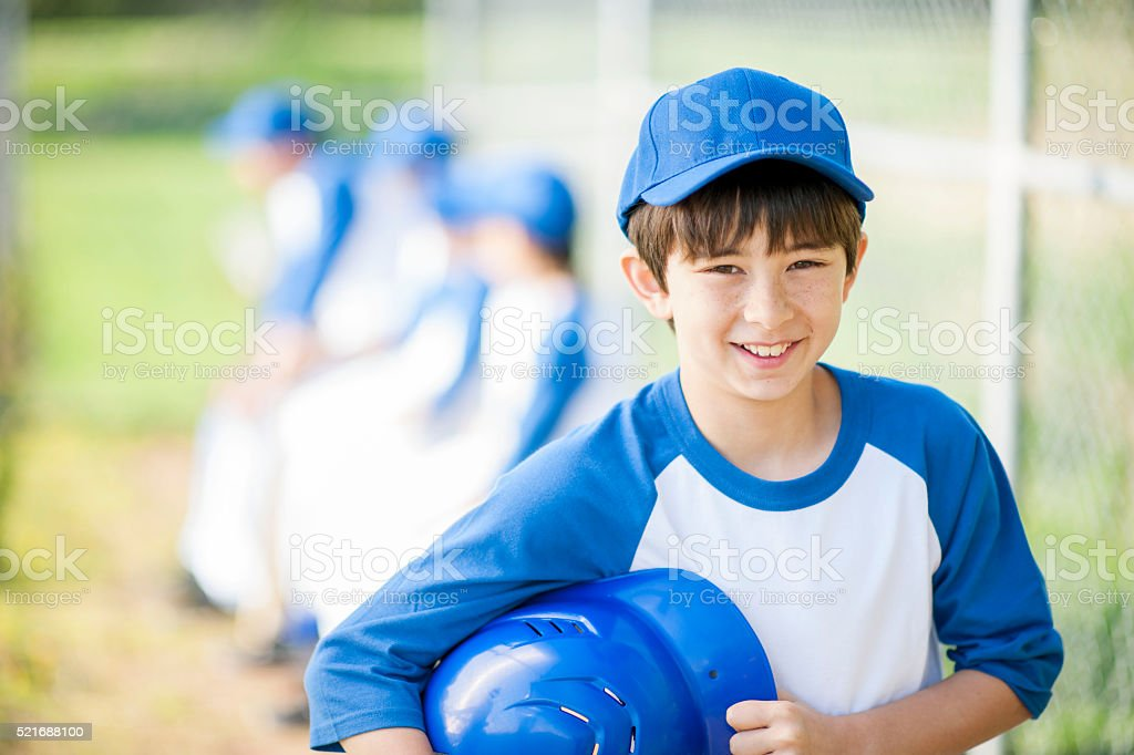 Young Boy Heading to the Plate stock photo