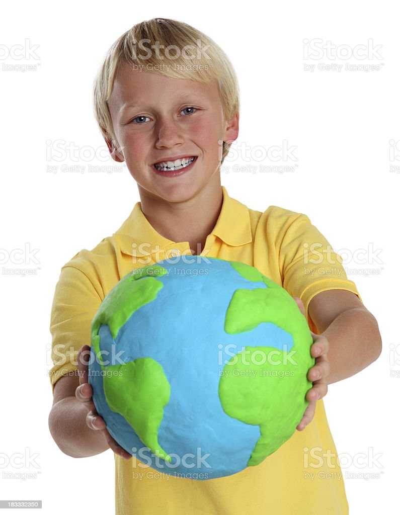 Young Boy Holding a Clay Globe stock photo