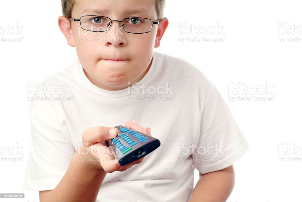 Young Boy Holding a TV Remote with a Serious Expression royalty-free stock photo